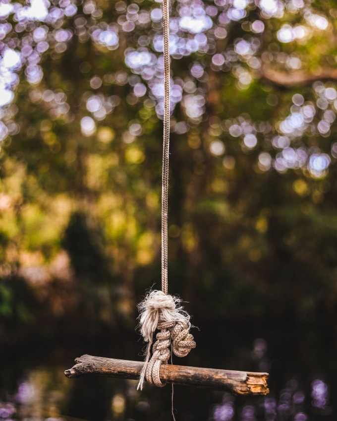 by Tadeu Jnr: Brown stick tied on gray rope
